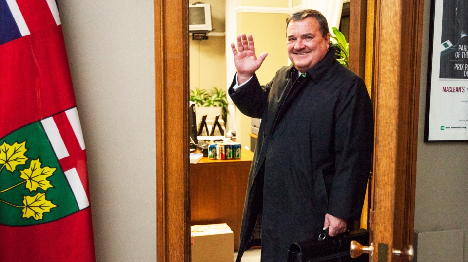 Finance Minister Jim Flaherty waves goodbye in this photo that was included in his statement of resignation from cabinet on Tuesday, March 18, 2014.