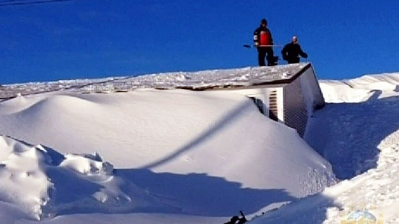 A Newfoundland couple returned home after being away for months to find their house completely buried in snow, and a week and a half later they're still digging themselves out.