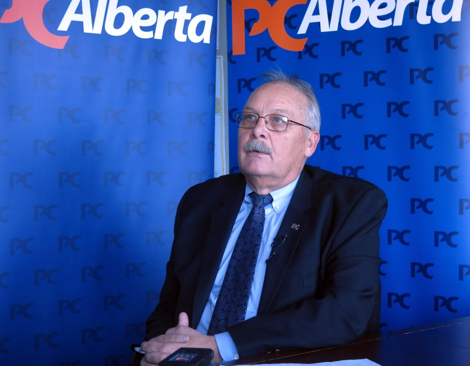 Jim McCormick, the president of the Progressive Conservative Party of Alberta, speaks to reporters in Calgary, Tuesday, March 18, 2014. (Bill Graveland / THE CANADIAN PRESS)