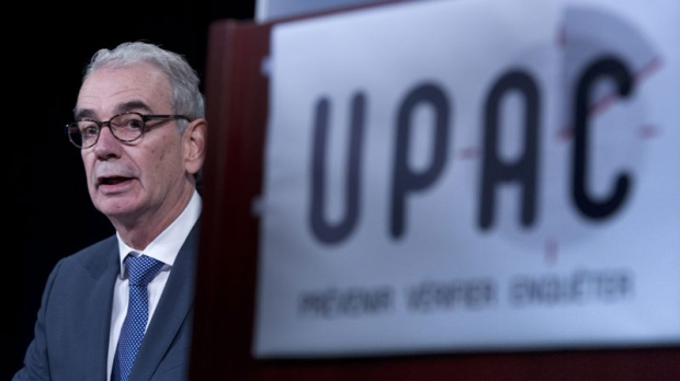 Quebec anti-corruption commissioner Robert Lafreniere delivers a statement during a news conference Monday, October 3, 2011 in Montreal.