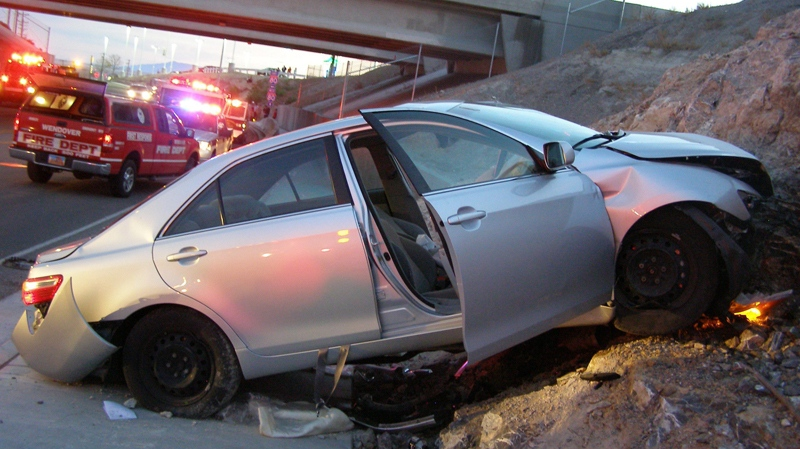 In this Nov. 5, 2010 photo released by the Utah Highway Patrol, a Toyota Camry is shown after it crashed as it exited Interstate 80 in Wendover, Utah. Police suspect problems with the Camry's accelerator or floor mat caused the crash that left two people dead and two others injured. (AP Photo/Utah Highway Patrol)