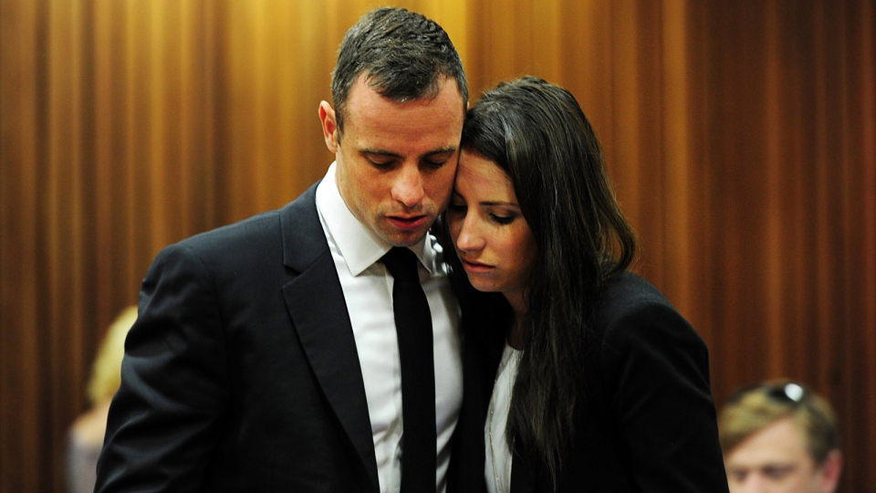 Oscar Pistorius hugs his sister Aimee, right, in court in Pretoria, South Africa, Wednesday, March 19, 2014. (AP / Leon Sadiki)