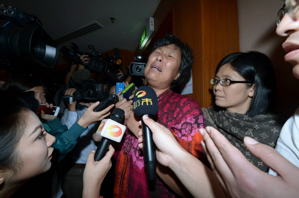 A Chinese relative of passengers aboard a missing Malaysia Airlines plane cries as she speaks to journalists at a hotel in Sepang, Malaysia, Wednesday, March 19, 2014. (AP Photo)
