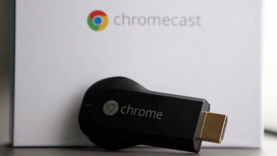 Google's Chromecast, a small device that works wirelessly to stream video and music to a high-definition TV, is displayed on Wednesday, July 31, 2013, in Atlanta. The Chromecast is controlled by a smartphone or tablet computer and lets the user connect and view content from services like YouTube and Netflix via Wi-Fi. (AP / Jaime Henry-White)