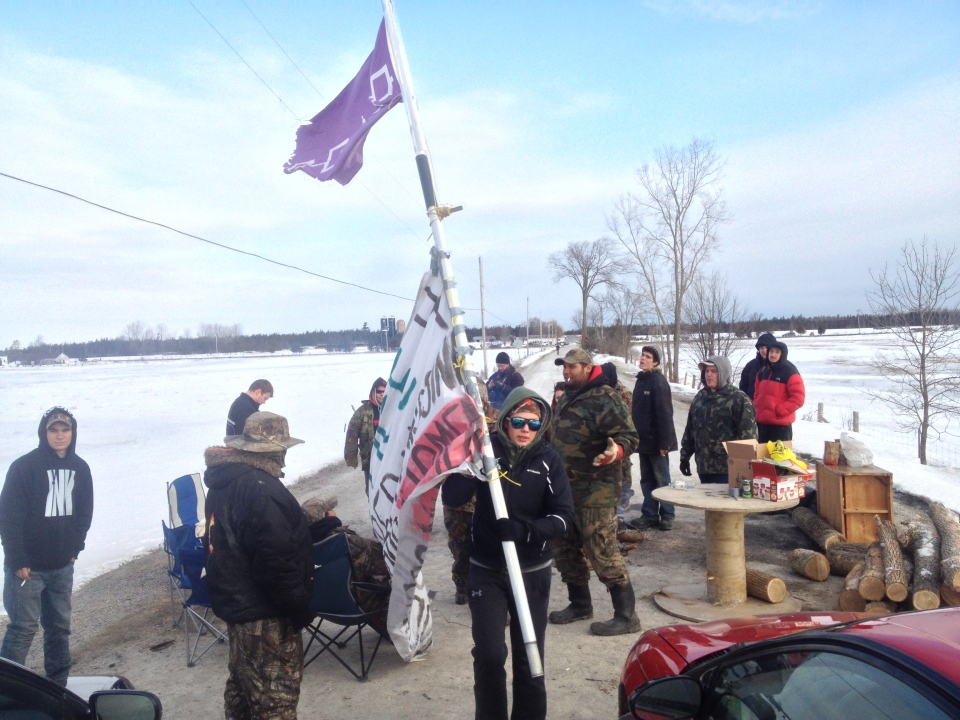 Protestors are seen at a blockade on a Via Rail line and Wymans Road west of Napanee, Ont. to raise awareness about missing and murdered aboriginal women, Wednesday, March 19, 2014.