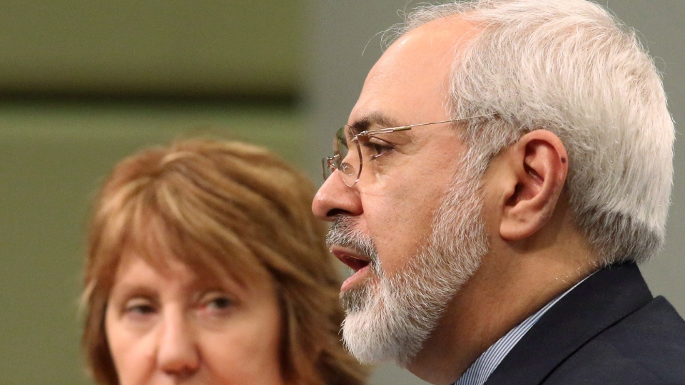 European foreign policy chief Catherine Ashton, left, and Iranian Foreign Minister Mohamad Javad Zarif, right, adress the media after closed-door nuclear talks in Vienna, Austria, Wednesday, March 19, 2014. (AP / Ronald Zak)