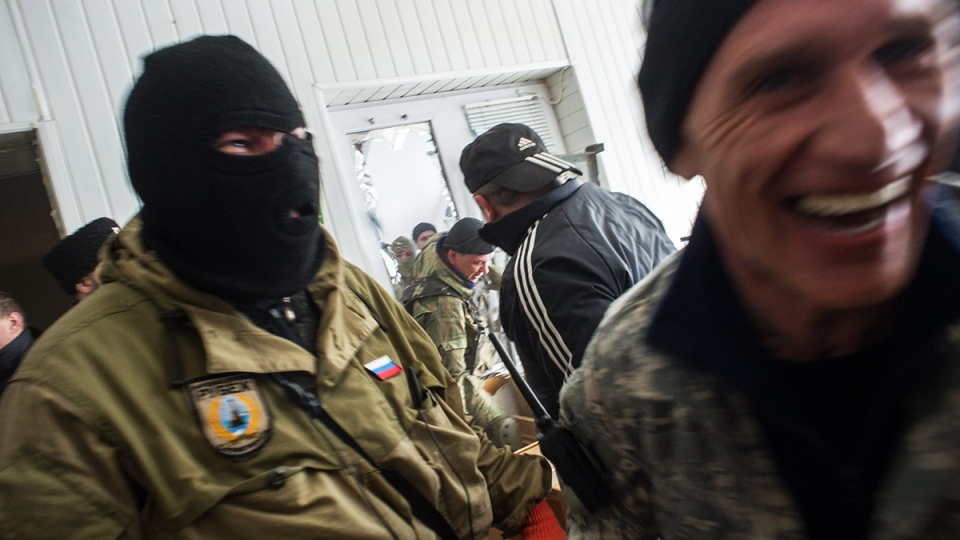 Crimean self-defense forces stand after storming the Ukrainian navy headquarters in Sevastopol, Crimea, Wednesday, March 19, 2014. (AP / Andrew Lubimov)