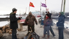 First Nations protesters blockade Via Rail tracks