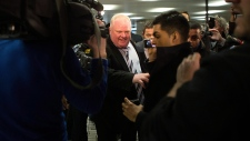 Toronto Mayor Rob Ford leaves his city hall office
