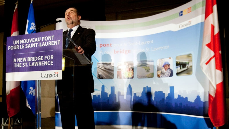 Federal Transport Minister Denis Lebel speaks to reporters a news conference to announce a new bridge to replace the Champlain Bridge in Montreal on Wednesday, October 5, 2011. (Ryan Remiorz / THE CANADIAN PRESS)