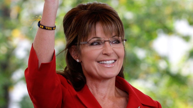 Former Republican vice presidential candidate and Alaska Gov. Sarah Palin waves to supporters before addressing a Tea Partly Express Rally in Manchester, N.H., on Sept. 5, 2011. (AP / Stephan Savoia, file)