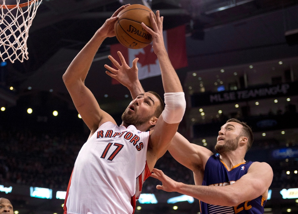 Toronto Raptors centre Jonas Valanciunas (17) rebounds against Phoenix Suns centre Miles Plumlee (22) during first half NBA action in Toronto on Sunday March 16, 2014. (Frank Gunn / THE CANADIAN PRESS)