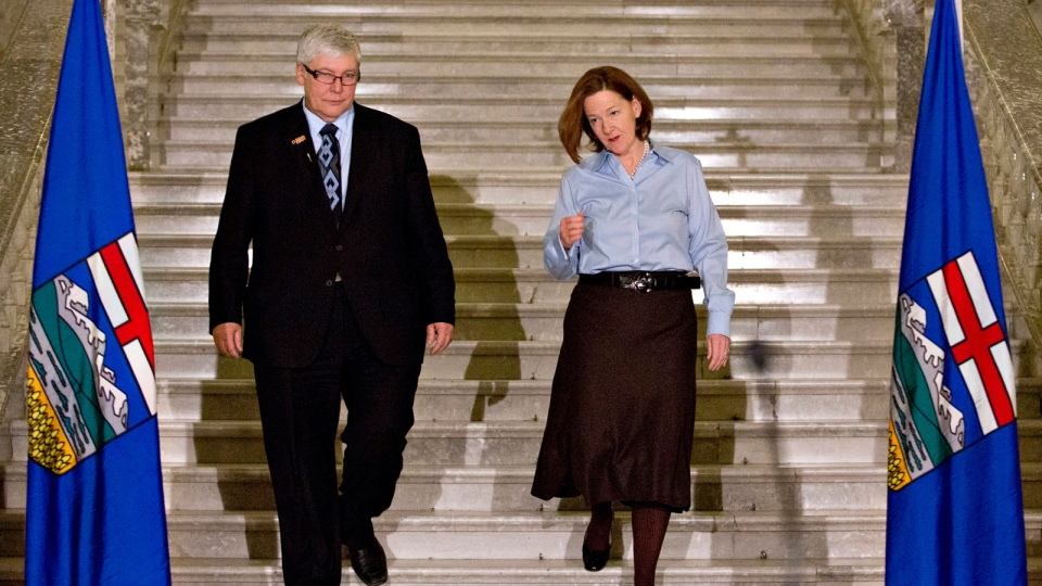 Deputy Premier Dave Hancock and Alberta Premier Alison Redford make their way to a press conference to announce Alison Redford's resignation in Edmonton on Wednesday, March 19, 2014. (Jason Franson / THE CANADIAN PRESS)