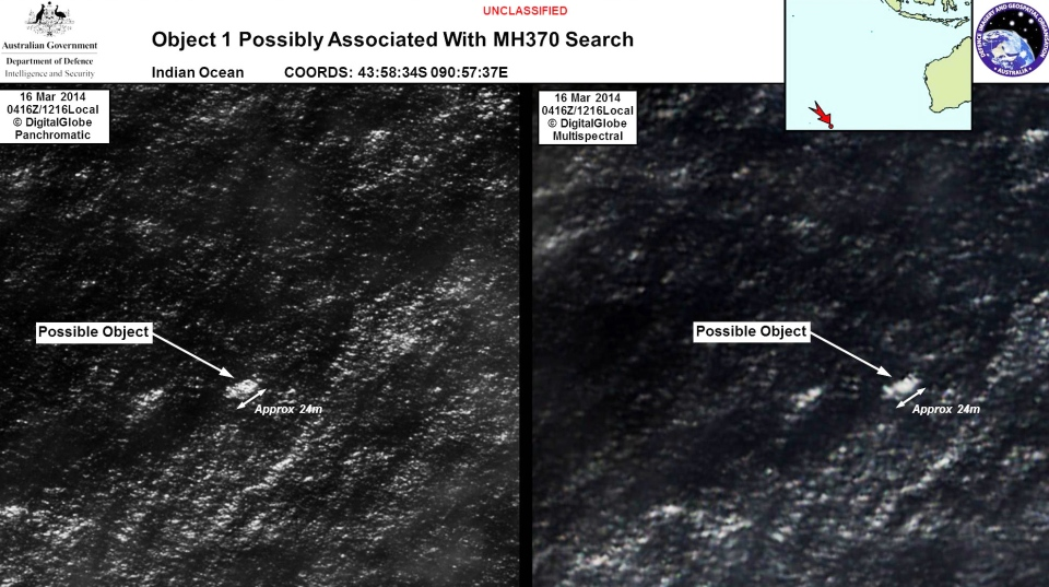 A floating object is seen at sea this satellite imagery on March 16, 2014. Australia's government reported Thursday, March 20, 2014 that the images show suspected debris from the missing Malaysia Airlines jetliner floating in an area 2,500 km southwest of Perth, Australia. (Commonwealth of Australia / Department of Defence)