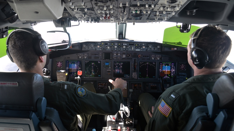 In this photo provided by the U.S. Navy, Lt. j.g. Kyle Atakturk, left, and Lt. j.g. Nicholas Horton, pilot a U.S. Navy P-8A Poseidon during a mission to assist in search and rescue operations for Malaysia Airlines flight MH370 Wednesday March 19, 2014. (AP Photo/US Navy, Mass Communication Specialist 2nd Class Eric A. Pastor)