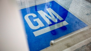The logo for General Motors decorates the entrance at the site of a GM information technology centre in Roswell, Ga., on Thursday, Jan. 10, 2013. (AP / David Goldman)