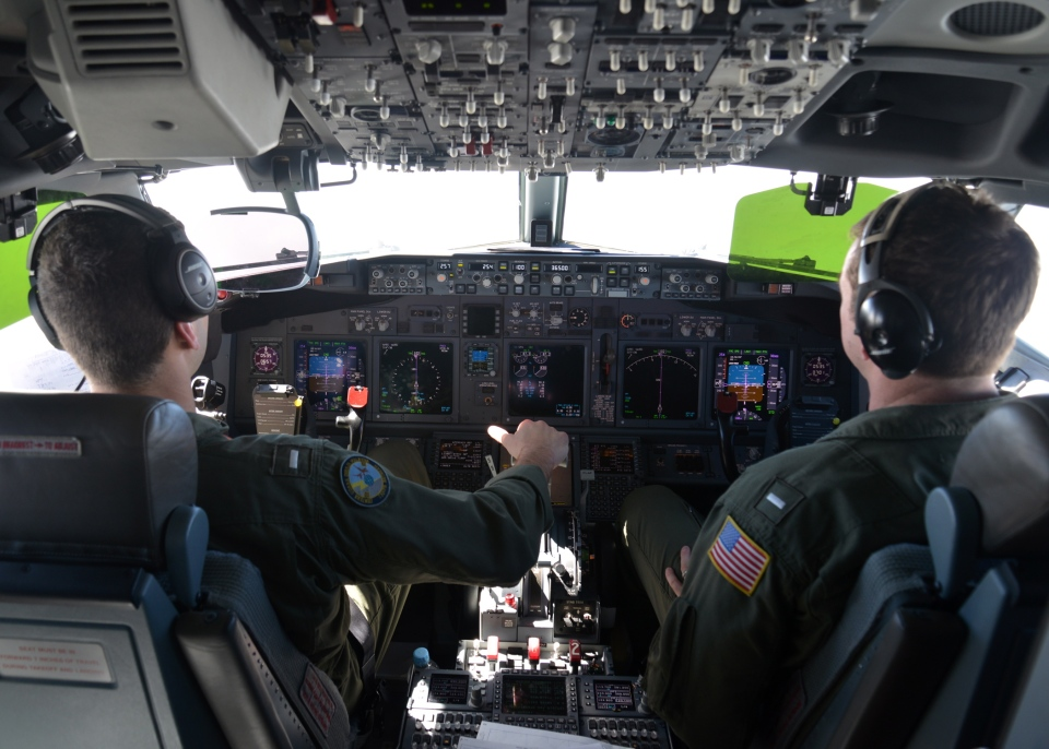 Lt. j.g. Kyle Atakturk, left, and Lt. j.g. Nicholas Horton, pilot a U.S. Navy P-8A Poseidon during a mission to assist in search and rescue operations for Malaysia Airlines flight MH370 Wednesday March 19, 2014. (US Navy / Mass Communication Specialist 2nd Class Eric A. Pastor)