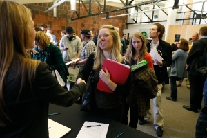 In this Thursday, March 13, 2014 photo, job seekers attend a marijuana industry job fair hosted by Open Vape, a vaporizer company, in Downtown Denver. (AP/Brennan Linsley)