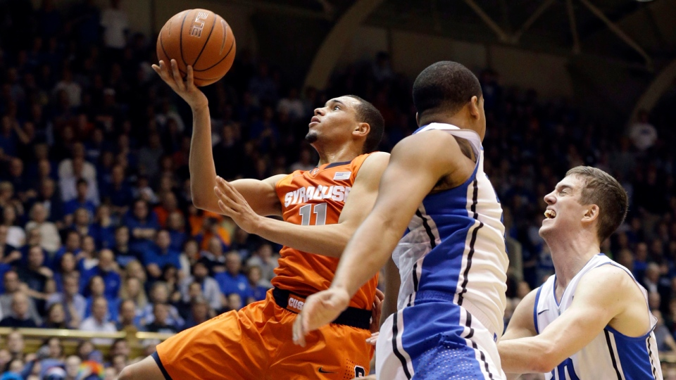 Syracuse's Tyler Ennis (11) drives to the basket against Duke's Marshall Plumlee, right, and Andre Dawkins during the first half of an NCAA college basketball game in Durham, N.C., Saturday, Feb. 22, 2014. (AP / Gerry Broome)
