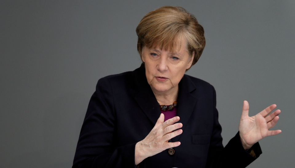 German Chancellor Angela Merkel gestures during a statement at the German parliament Bundestag, in Berlin, Thursday, March 20, 2014. (AP / Michael Sohn)