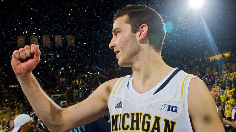 Michigan guard Nik Stauskas (11) cheers after an NCAA college basketball game against Indiana in Ann Arbor, Mich., Saturday, March 8, 2014. (AP / Tony Ding)