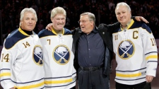 Buffalo Sabres owner Terry Pegula, second from right, poses with former Sabres players Rene Robert (14), Rick Martin (7) and Gilbert Perreault (11) before an NHL hockey game against the Atlanta Thrashers in Buffalo, N.Y. in this photo taken Feb. 23, 2011. (AP / David Duprey)