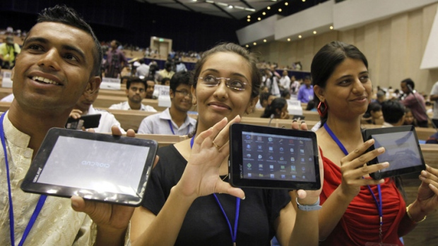 Indian students pose with the  'Aakash' Tablet