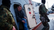 Men wearing masks seize Ukrainian ship in Crimea