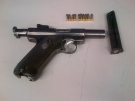 A Ruger .22 caliber semi-automatic handgun seized during a search on Wednesday, March 20, 2014 is seen in this image released by the London Police Service.