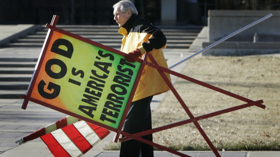 The Rev. Fred Phelps Sr. prepares to protest outside the Kansas Statehouse in Topeka, Kan., July 1, 2007. (AP / Orlin Wagner)