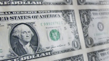 A sheet of one dollar bills hangs inside the Gilbert Stuart Birthplace and Museum in the village of Saunderstown in North Kingstown, R.I., birthplace of American painter Gilbert Stuart, in this Thursday, May 16, 2002 file photo. (AP Photo/Victoria Arocho, FILE)