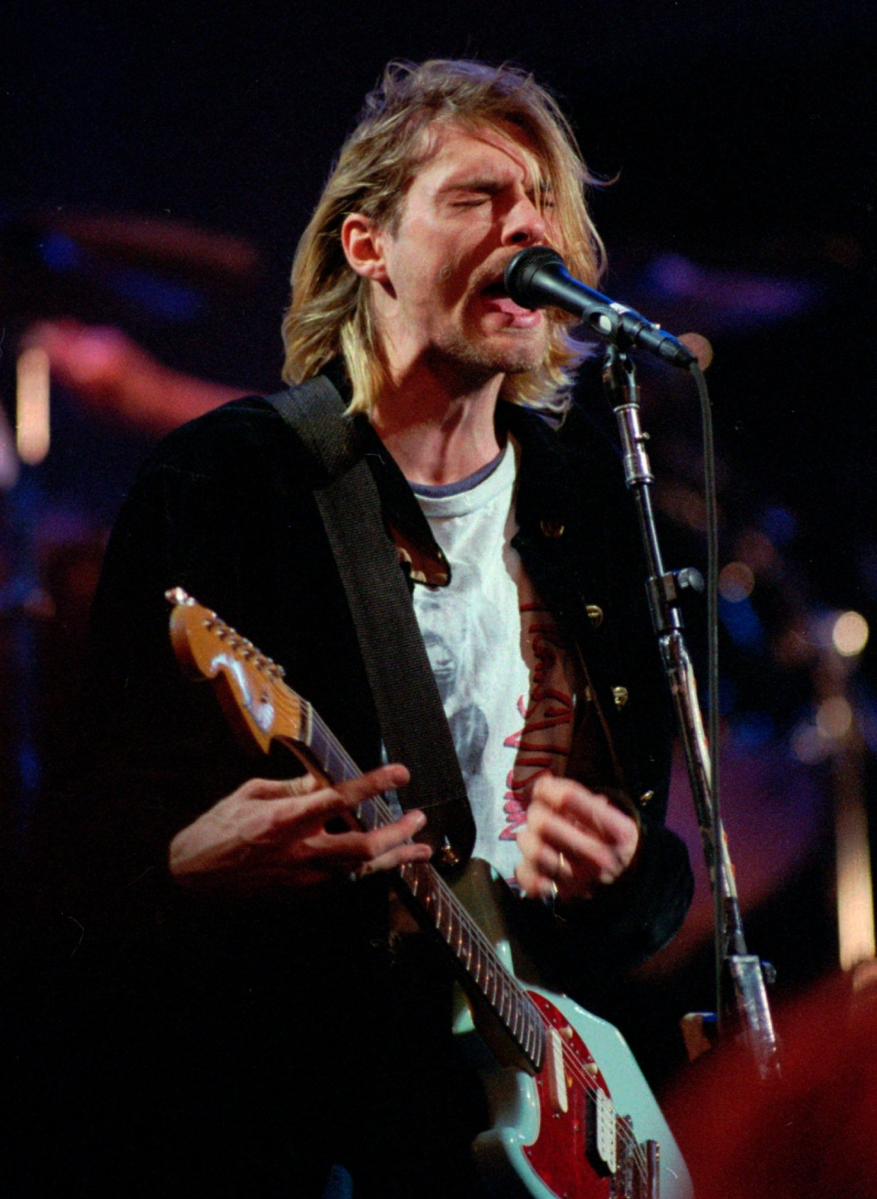 In this Dec. 13, 1993 file photo, Kurt Cobain, lead singer for the band Nirvana, performs during the taping of MTV's Live and Loud Production in Seattle. (AP/Robert Sorbo, File)