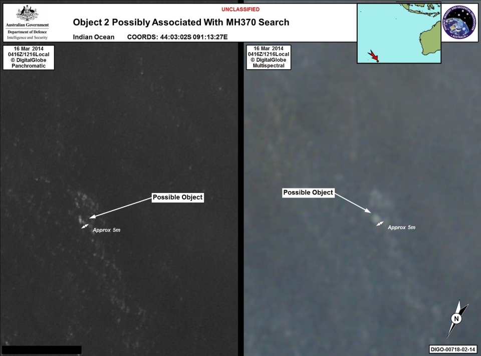 In this March 16, 2014 satellite imagery provided by Commonwealth of Australia - Department of Defence on Thursday, March 20, 2014, a floating object is seen at sea next to the descriptor which was added by the source. (AP / Commonwealth of Australia - Department of Defence)