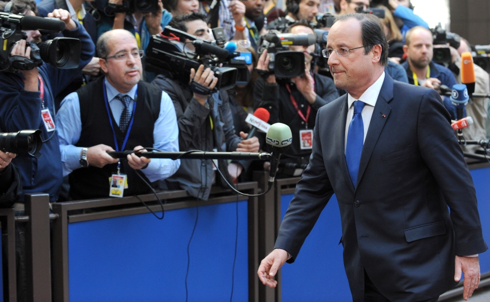 French President Francois Hollande, right, arrives for an EU summit in Brussels on Thursday, March 20, 2014. (AP / Eric Vidal)