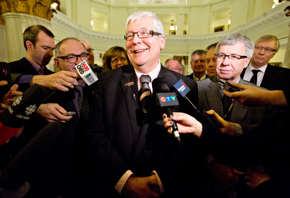 Deputy Premier Dave Hancock leaves a press conference after announcing that he was chosen interim premier, in Edmonton, Alberta on Thursday March 20, 2014 following the resignation of Alberta Premier Alison Redford. (Jason Franson / THE CANADIAN PRESS)