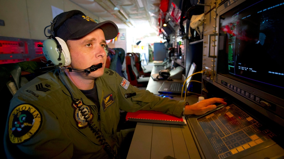 Royal Australian Air Force Airborne Electronics Analyst, Flight Sgt. Tom Stewart from 10 Squadron, on board an AP-3C Orion watches a radar screen over the Southern Indian Ocean off the Western Australian coast during a search operation for the missing Malaysia Airlines flight MH370, Wednesday, March 19, 2014. (Australia Defence Department, Hamish Paterson)