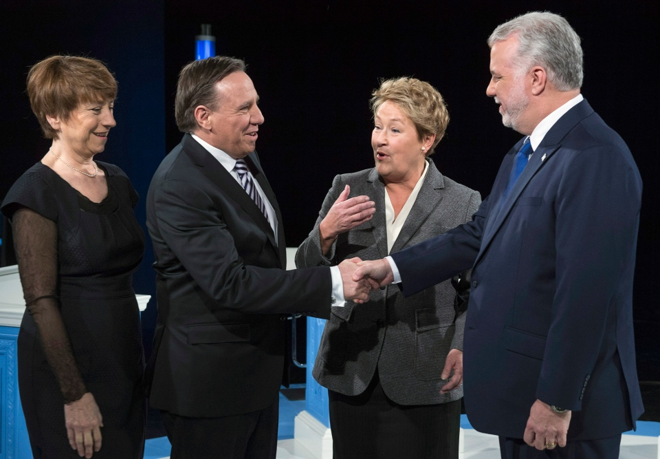 CAQ leader Francois Legault shakes hands with Liberal leader Philippe Couillard as PQ leader Pauline Marois and Quebec Solidaire leader Francoise David, left, look on prior to the leaders' debate Thursday, Thursday, March 20, 2014 in Montreal. (Paul Chiasson / THE CANADIAN PRESS)
