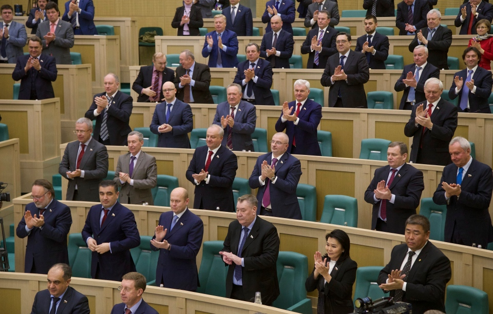 Federation Council members applaud their voting, in the Russian parliament's upper chamber in Moscow, Russia, Friday, March 21, 2014. (AP / Alexander Zemlianichenko)