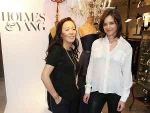 This Sept. 24, 2009 file photo shows actress Katie Holmes, right, and Jeanne Yang at the Holmes & Yang launch party in Los Angeles. (AP Photo/Perrier Jouet Champagne, Casey Rodgers)