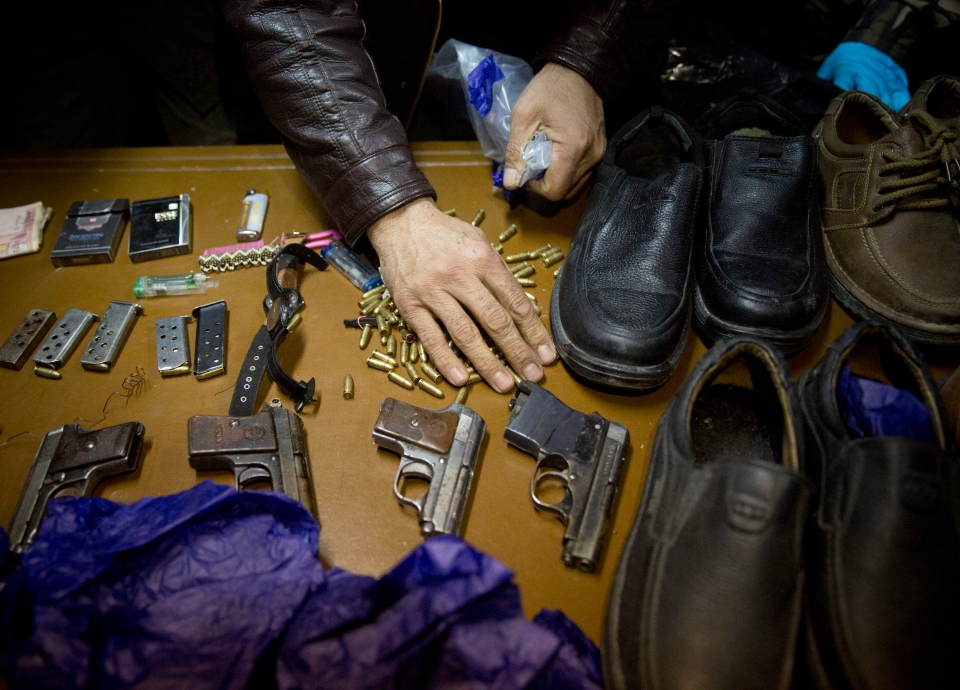 Afghanistan's intelligence service displays some of the weapons and belongings collected from the attackers on the Serena hotel on Thursday, during a press conference at the Interior ministry in Kabul, Afghanistan, Friday, March 21, 2014. (AP / Anja Niedringhaus)
