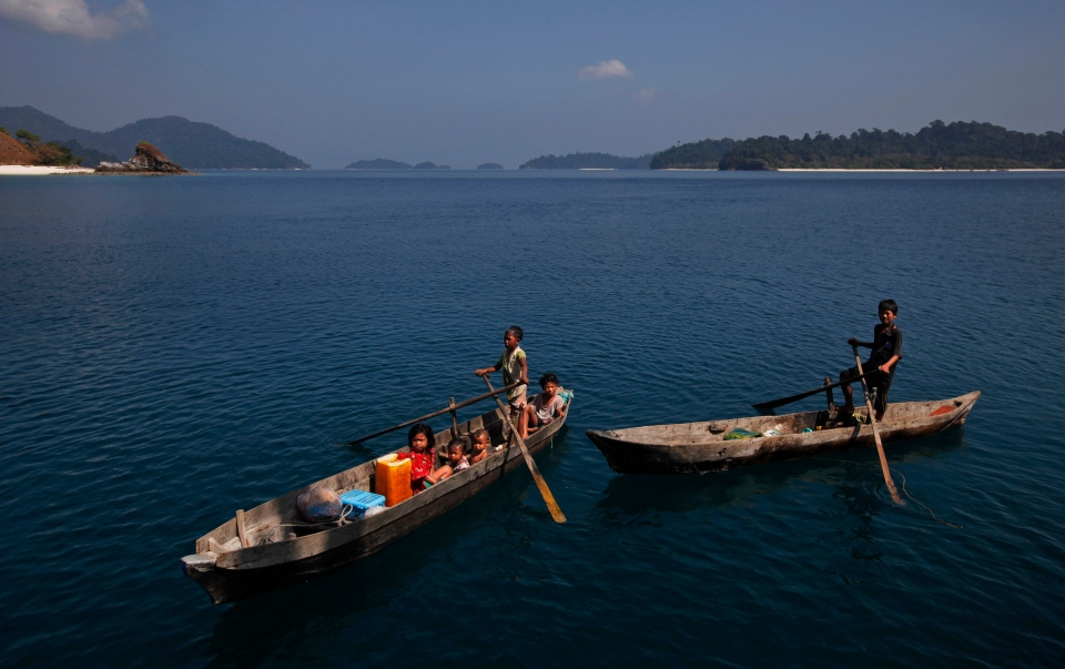 Moken children, nomads of the sea, paddle their canoe near Island 115 in Mergui Archipelago, Myanmar. (AP / Altaf Qadri)