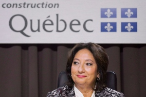 Justice France Charbonneau smiles as she sits on the opening day of a Quebec inquiry looking into allegations of corruption in the province's construction industry in Montreal, Tuesday, May 22, 2012. The Parti Quebecois has issued an ad that uses the head of the Charbonneau corruption inquiry to attack the integrity of the Liberals. THE CANADIAN PRESS/Graham Hughes