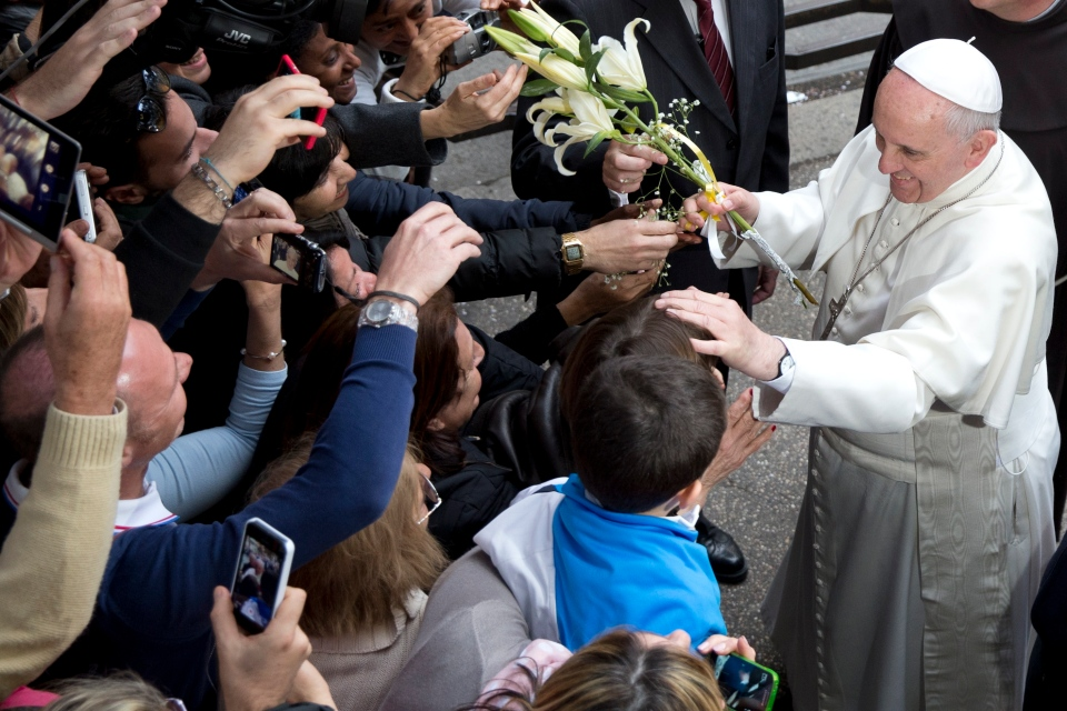 Pope Francis is cheered by faithful as he arrives for a meeting with relatives of innocent mafia victims, in Rome's St. Gregorio VII church, just outside the Vatican, Friday, March 21, 2014. (AP / Andrew Medichini)
