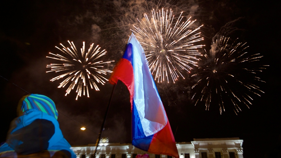 People watch fireworks at the central Lenin square in Simferopol, Crimea, on Friday, March 21, 2014. (AP / Ivan Sekretarev)