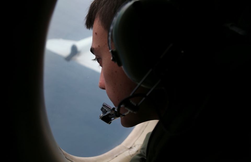 Sgt. Matthew Falanga on board a Royal Australian Air Force AP-3C Orion, search for the missing Malaysia Airlines flight MH370 in southern Indian Ocean, Australia, Saturday, March 22, 2014. (AP / Rob Griffith)