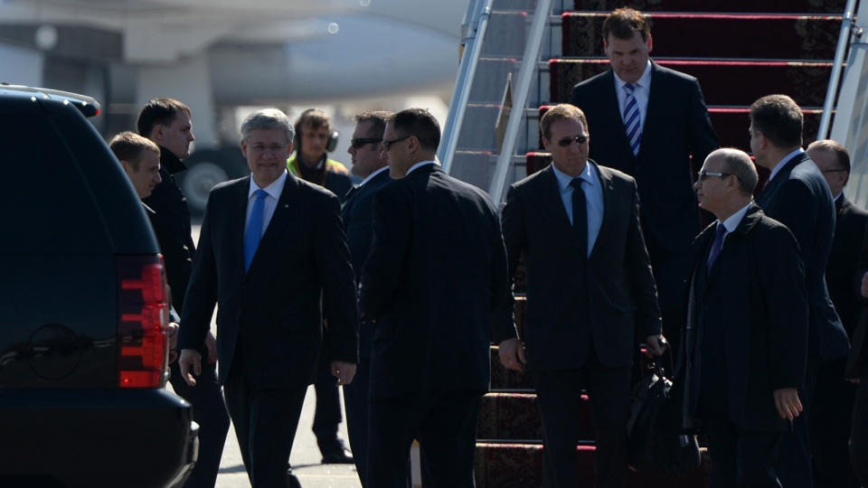 Prime Minister Stephen Harper, Minister of Justice Peter MacKay, and Minister of Foreign Affairs John Baird arrive in Kyiv, Ukraine, on Saturday, March 22, 2014. (THE CANADIAN PRESS / Sean Kilpatrick)