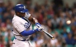 The Los Angeles Dodgers' Yasiel Puig flies out to center in the top of the 9th inning during the Major League Baseball opening game between the Los Angeles Dodgers and Arizona Diamondbacks at the Sydney Cricket ground in Sydney, Saturday, March 22, 2014. The Dodgers won the game 3-1. (AP Photo/Rick Rycroft)