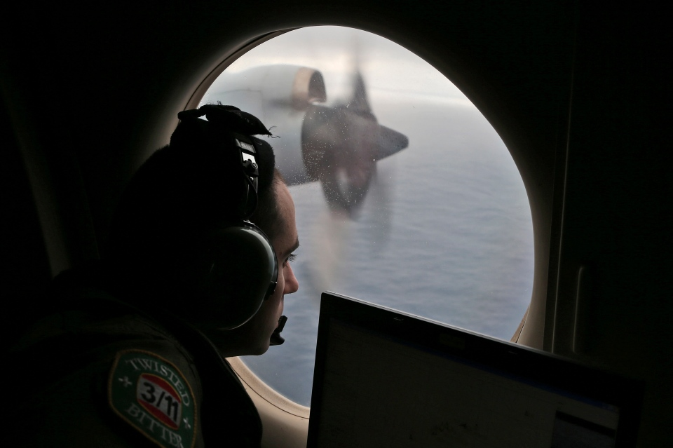 Flight officer Rayan Gharazeddine on board a Royal Australian Air Force AP-3C Orion, searches for the missing Malaysia Airlines Flight MH370 in southern Indian Ocean, Australia, Saturday, March 22, 2014. (AP / Rob Griffith)