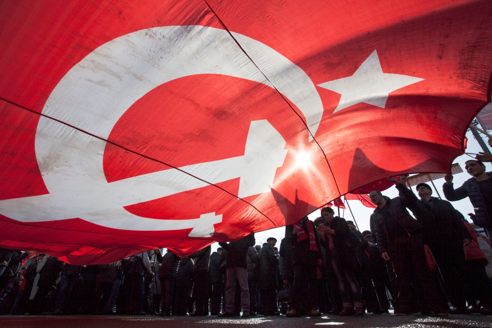 Russian Communist party supporters carry a huge former Soviet Union Red flag during a rally in support of Crimea joining Russia near the Red Square in Moscow on March 22, 2014. (AP Photo/Alexander Zemlianichenko Jr)