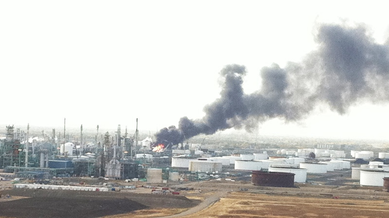 Flames and smoke are seen after an explosion at the Co-op crude oil refinery in Regina on Thursday, Oct. 6, 2011. (Shaun Reich / MyNews.CTV.ca)